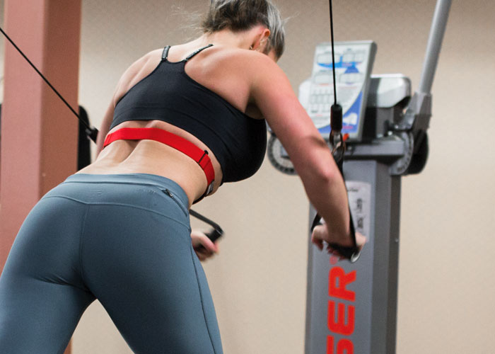 Woman using resistance machines